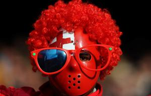 WELLINGTON, NEW ZEALAND - OCTOBER 01:  A tonga fan cheers his team on during the IRB 2011 Rugby World Cup Pool A match between France and Tonga at Wellington Regional Stadium on October 1, 2011 in Wellington, New Zealand.  (Photo by Mike Hewitt/Getty Images)