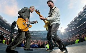 Adam Clayton (left) and The Edge from U2 playing at Croke Park in Dublin