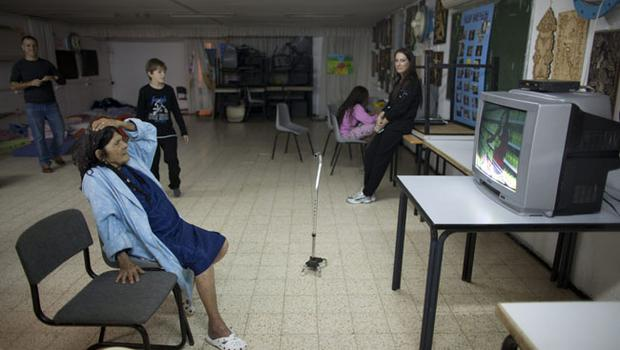 NETIVOT, ISRAEL - NOVEMBER 14:  (ISRAEL OUT) Israelis watch TV in a bomb shelter on November 14, 2012 in Netivot, Israel. Israel Defense Forces launched aerial attacks on targets in Gaza that killed the top military commander of Hamas, (Photo by Uriel Sinai/Getty Images)