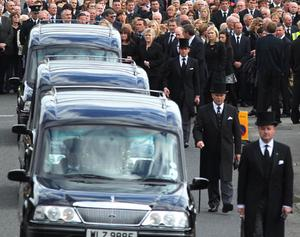 The funeral cortage  of Noel Spence and his two sons Graham (30) and Nevin (22) at Ballynahinch Baptist Church