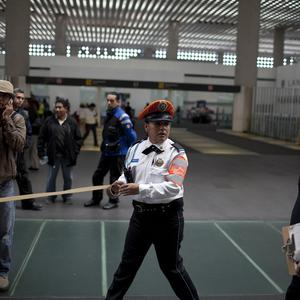 Police cordon off the scene where two fellow officers were shot dead at Mexico City's international airport (AP)