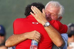 Rory McIlroy of Northern Ireland hugs his father Gerry McIlroy after the final round of the PGA Championship golf tournament on the Ocean Course of the Kiawah Island Golf Resort in Kiawah Island, S.C., Sunday, Aug. 12, 2012. (AP Photo/Chuck Burton)