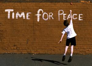 A young boy plays against a wall in North Belfast on the eve of the 1994 IRA ceasefire. Picture by Crispin Rodwell