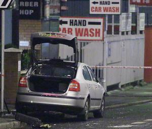 The burnt-out police car attacked by a mob in east Belfast on Monday night