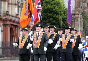 Orangemen take part in Twelfth of July parades as they make their way to the field at Shaws Bridge, Belfast. The County Grand Lodge Colour Party lead of the parade