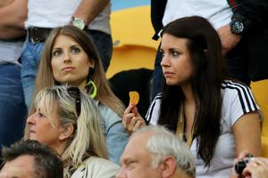 L'VIV, UKRAINE - JUNE 09:  Cathy Fischer (L), girlfriend of Mats Hummels and Jenny, girlfriend of Marcel Schmelzer during the UEFA EURO 2012 group B match between Germany and Portugal at Arena Lviv on June 9, 2012 in L'viv, Ukraine.  (Photo by Joern Pollex/Getty Images)