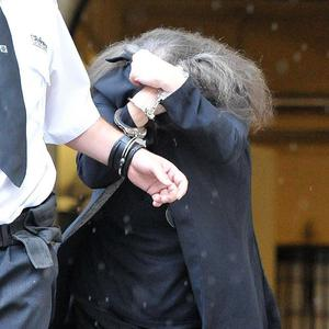 Yvonne Freaney, who strangled her severely disabled son, is escorted from Cardiff Crown Court