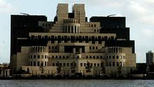 London Buildings MI5 on the banks of the River Thames which is in the foreground,