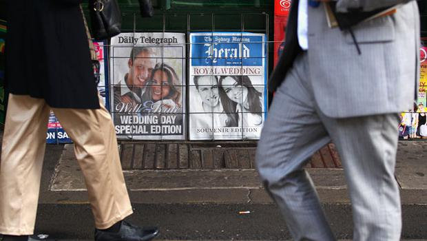 Commuters walk past a newsagent on the day of The Royal Wedding at Circular Quay on April 29, 2011 in Sydney, Australia