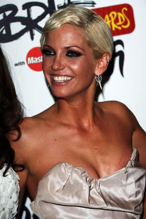 LONDON - FEBRUARY 18:  Sarah Harding of Girls Aloud poses after winning the Best British Single backstage at the Brit Awards 2009 at Earls Court on February 18, 2009 in London, England.  (Photo by Tim Whitby/Getty Images)
