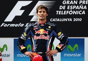 Red Bull's Mark Webber won his first race of the season in Barcelona as McLaren's Lewis Hamilton lost second place in a dramatic finish