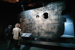 People look at the 15 ton 13' by 30' portion of the First-Class C-Deck hull, one of the artifacts from the Titanic, at the Metreon on June 6, 2006 in San Francisco, California.