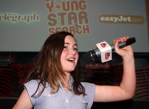 Caitlin Cochrane from Glengormley on stage at the City Beat Young Star search auditions