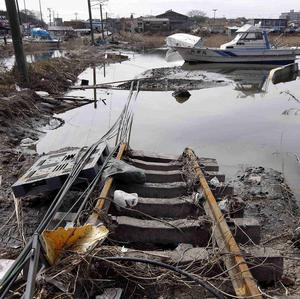 Railway lines disappear into water in Shiogama, Miyagi Prefecture, following the devastating tsunami (AP)