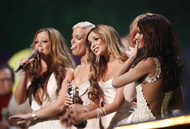 British band Girls Aloud react after collecting the Best British Single Award  at the Brit Awards 2009 at Earls Court exhibition centre in London, England, Wednesday, Feb. 18, 2009. (AP Photo/MJ Kim)