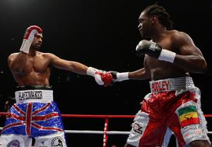 David Haye (left) and Audley Harrison work each other out in the second round during the WBA World Heavyweight Championship Title fight at the MEN Arena, Manchester. PRESS ASSOCIATION Photo. Picture date: Saturday November 13, 2010. David Haye has beaten Audley Harrison by third-round stoppage to retain his WBA heavyweight title in Manchester. See PA Story BOXING Manchester. Photo credit should read: Dave Thompson/PA Wire.