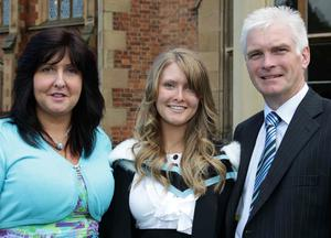 Queen' s University summer Graduation. July 2010.   nLinzi Bell from Ballyclare who graduated with a BA in Early Childhood Studies is joined by her parents Evelyn and Philip.