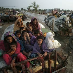 Pakistani villagers flee their homes due to heavy flooding in Qadirpur near Sukkur