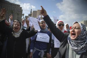 Women shout during an anti-government demonstration in Cairo, Egypt, Monday Jan. 31, 2011. A coalition of opposition groups called for a million people to take to Cairo's streets Tuesday to ratchet up pressure for President Hosni Mubarak to leave.  (AP Photo/Mohammed Abou Zaid)