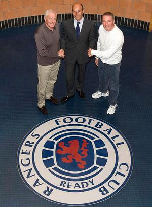 Deal me in: Rangers manager Walter Smith and assistant boss Ally McCoist shake hands on their new contracts with the club's chief executive Martin Bain