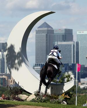 Great Britain's Nicola Wilson riding Opposition Buzz jumps The Moon fence on the cross country course during The Eventing at Greenwich Park, on the third day of the London 2012 Olympics.