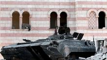 In this Tuesday, July 24, 2012 photo, a damaged Syrian military tank is seen at the border town of Azaz, some 20 miles (32 kilometers) north of Aleppo, Syria. Turkey sealed its border with Syria to trucks on Wednesday, July 25, 2012 cutting off a vital supply line to the embattled nation as fighting stretched into its fifth day in the commercial capital of Aleppo. (AP Photo/Turkpix)