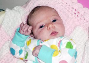 """Elizabeth McConville, who will be known as Beth, was born at 9.29am on June 10. <p><b>To send us your Baby Pics <a href=""""http://www.belfasttelegraph.co.uk/usersubmission/the-belfast-telegraph-wants-to-hear-from-you-13927437.html"""" title=""""Click here to send your pics to Belfast Telegraph"""">Click here</a> </a></p></b>"""