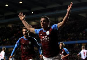 BIRMINGHAM, ENGLAND - APRIL 24:  Stephen Warnock of Aston Villa celebrates scoring the opening goal during the Barclays Premier League match between Aston Villa and Bolton Wanderers at Villa Park on April 24, 2012 in Birmingham, England.  (Photo by Michael Steele/Getty Images)