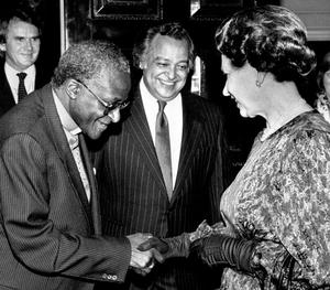 File photo dated 09/03/1987 of Queen Elizabeth II meeting the Anglican Archbishop of Cape Town, Desmond Tutu at a Commonwealth Day Reception at Marlborough House, London, with Sir Shridath Ramphal, Secretary-General of the Commonwealth, looking on. PRESS ASSOCIATION Photo