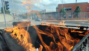 Burning bins and burnt out cars blocking the roads at Broadway in Belfast