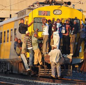 Passengers have set a fire to a South African commuter train over a fare dispute (AP)