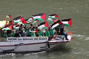 Pro-Palestinian activists demonstrate a day before the expected arrival of a flotilla of hundreds of pro-Palestinian activists carrying 10,000 tons of supplies into the Gaza Strip, in Paris, Friday May 28, 2010