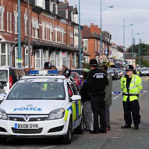 Police officers at the scene in the Winson Green area of Birmingham where three men died after being hit by a car