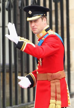 LONDON, ENGLAND - APRIL 29:  Prince William waves to the crowd as he arrives with Prince Harry for the Royal Wedding of Prince William to Catherine Middleton at Westminster Abbey on April 29, 2011 in London, England. The marriage of the second in line to the British throne is to be led by the Archbishop of Canterbury and will be attended by 1900 guests, including foreign Royal family members and heads of state. Thousands of well-wishers from around the world have also flocked to London to witness the spectacle and pageantry of the Royal Wedding.  (Photo by Dan Kitwood/Getty Images)