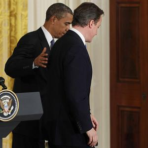 Barack Obama and David Cameron leave a joint news conference in the East Room of the White House (AP)