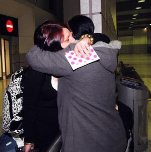 Denise Harris (right) greets her daughter Claire Lears as she arrives home from Tunisia