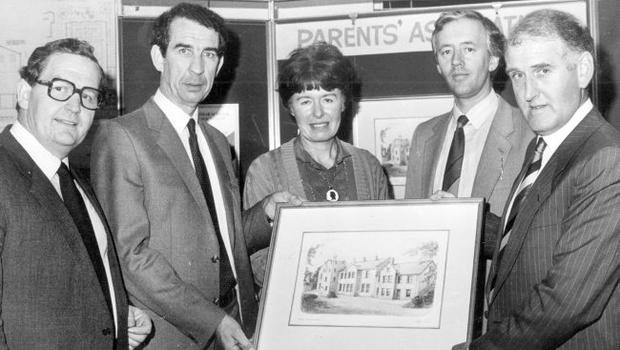 Mr. Jim Claney (right), outgoing, chairman of Bangor Grammar School Parents' Association, hands over an original painting of the school to Mr. Brian Thompson, chairman of the Board of Governors and launches the sale of limited edition prints for old boys and parents. Included (from left) are: Mr. Tom Patton, headmaster; Ms. Phyllis Arnold, the artist; and Mr. Michael Curry, chairman of the Parents' Association, 1985.