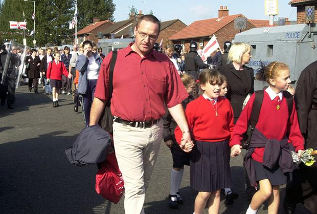 Catholic children walking to the Holy Cross Primary School.
