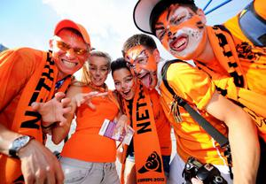 KHARKOV, UKRAINE - JUNE 09:  Dutch fans soak up the atmopshere prior to the UEFA EURO 2012 group B match between Netherlands and Denmark at Metalist Stadium on June 9, 2012 in Kharkov, Ukraine.  (Photo by Lars Baron/Getty Images)