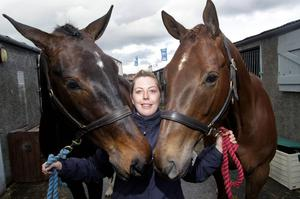 Janice Neil pictured with horses Bernie and Alfie