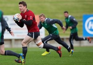 TAKAPUNA, NEW ZEALAND - JUNE 05:  Brian O'Driscoll of Ireland runs the ball during the Ireland team training session at Onewa Domain on June 5, 2012 in Takapuna, New Zealand.  (Photo by Sandra Mu/Getty Images)