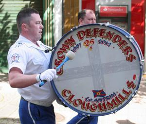 Kevin McAuley Photography Multimedia..Playing the Crown defenders Base Drum on parade at the North Antrim Demonstration in Cloughmills. Picture Matthew Steele/Kevin McAuley Photography Multimedia