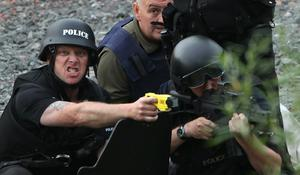 Police negotiate with a man fitting the description of fugitive gunman Raoul Moat on July 9, 2010 in Rothbury, England