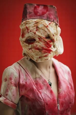 LONDON, ENGLAND - OCTOBER 26:  Meg Parrington, 17, from Ashford poses as a Nurse from Silent Hill  ahead of the MCM London Comic Con Expo at ExCel on October 26, 2012 in London, England. Visitors to the Comic Convention are encouraged to wear a costume of their favourite comic character and flock to the Expo to gather all the latest news in the world of comics, manga, anime, film, cosplay, games and cult fiction.  (Photo by Dan Kitwood/Getty Images)