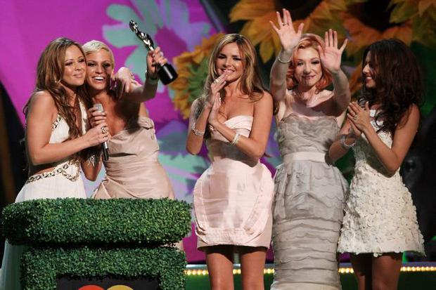 LONDON - FEBRUARY 18:  (UK TABLOID NEWSPAPERS OUT) L-R Kimberley Walsh, Sarah Harding, Nadine Coyle, Nicola Roberts and Cheryl Cole collect their Best Single Award at the Brit Awards 2009 held at Earls Court on February 18, 2009 in London, England.  (Photo by Dave Hogan/Getty Images)