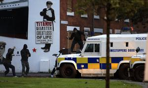 Loyalist rioters attack Police vehicle in East Belfast, Northern Ireland, Tuesday, June, 21, 2011.    Northern Ireland police faced a second night of attacks from rioters in east Belfast Tuesday, where sectarian rioting saw two people shot and homes attacked with gasoline bombs the previous night.   (AP Photo/Peter Morrison)