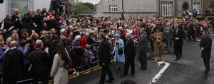 Queen Elizabeth II and the Duke of Edinburgh speak with well wishers in Enniskillen, County Fermanagh, during a two-day visit to Northern Ireland as part of the Diamond Jubilee tour.