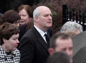 Laurence Wilson, who survived Thursday's plane crash at Cork Airport, attends the funeral of Brendan  McAleese
