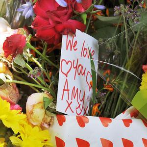 Notes and floral tributes left outside the home of singer Amy Winehouse in Camden Square, north London