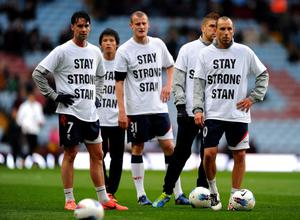BIRMINGHAM, ENGLAND - APRIL 24:  Martin Petrov (R) of Bolton Wanderers and his team mates wear  T-shirts showing their support for Stiliyan Petrov prior to the Barclays Premier League match between Aston Villa and Bolton Wanderers at Villa Park on April 24, 2012 in Birmingham, England.  (Photo by Laurence Griffiths/Getty Images)
